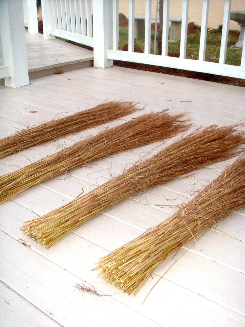 grass broom piles